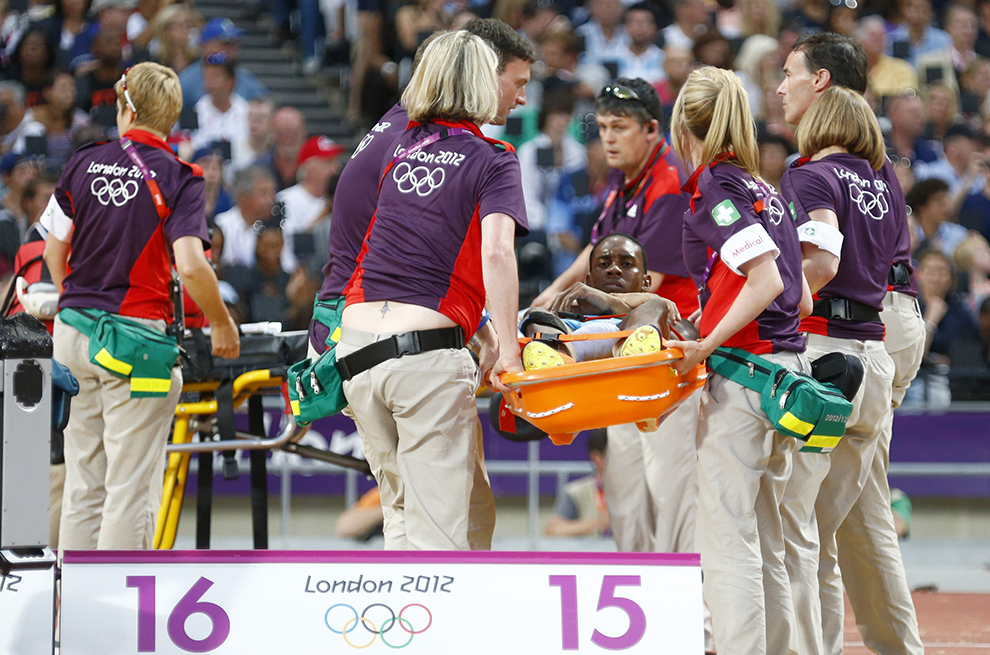 Bahamas' Leevan Sands is carried off on stretcher by medical staff following injury in men's triple jump final at London 2012 Olympic Games