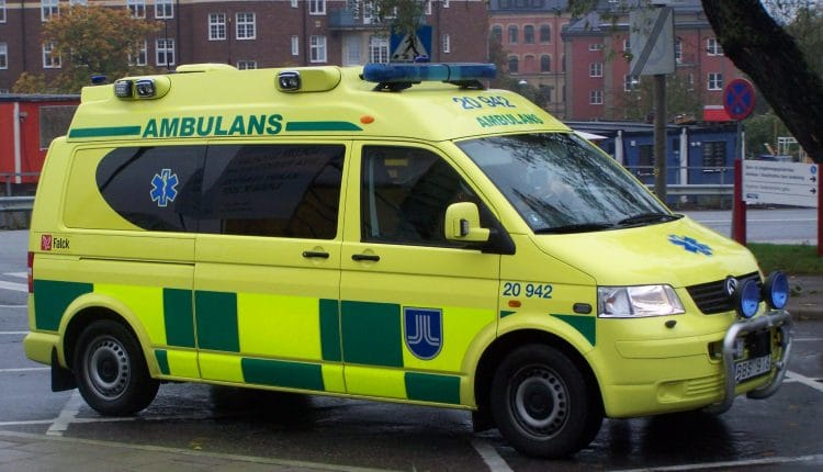 Yellow_VW_ambulance_with_high_visibilty_marking,_Sweden