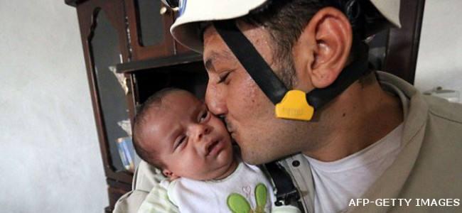 20140714115532-baby_rescue_aleppo_rubble