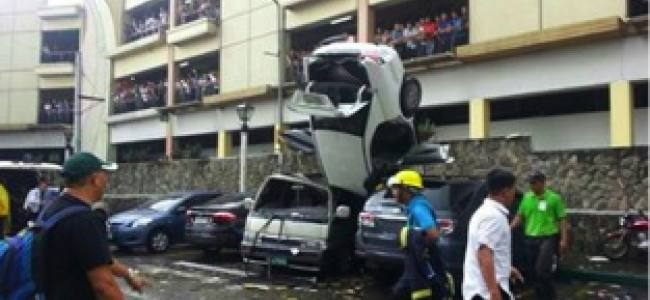 Strange Crash: Car Falls Out of Parking Structure