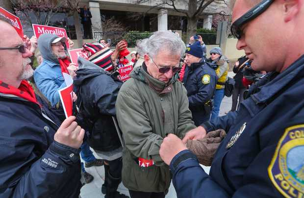 Pro-Medicaid expansion supporter arrested (Photo Columbia)
