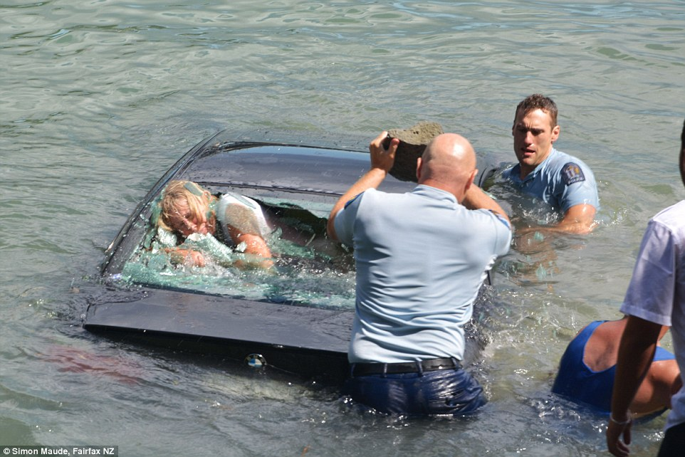 Cops rescue driver trapped in submerged car in New Zealand