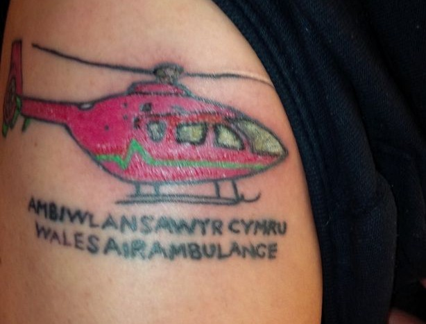 Strange Tattoos: Your Air Ambulance Service on arms