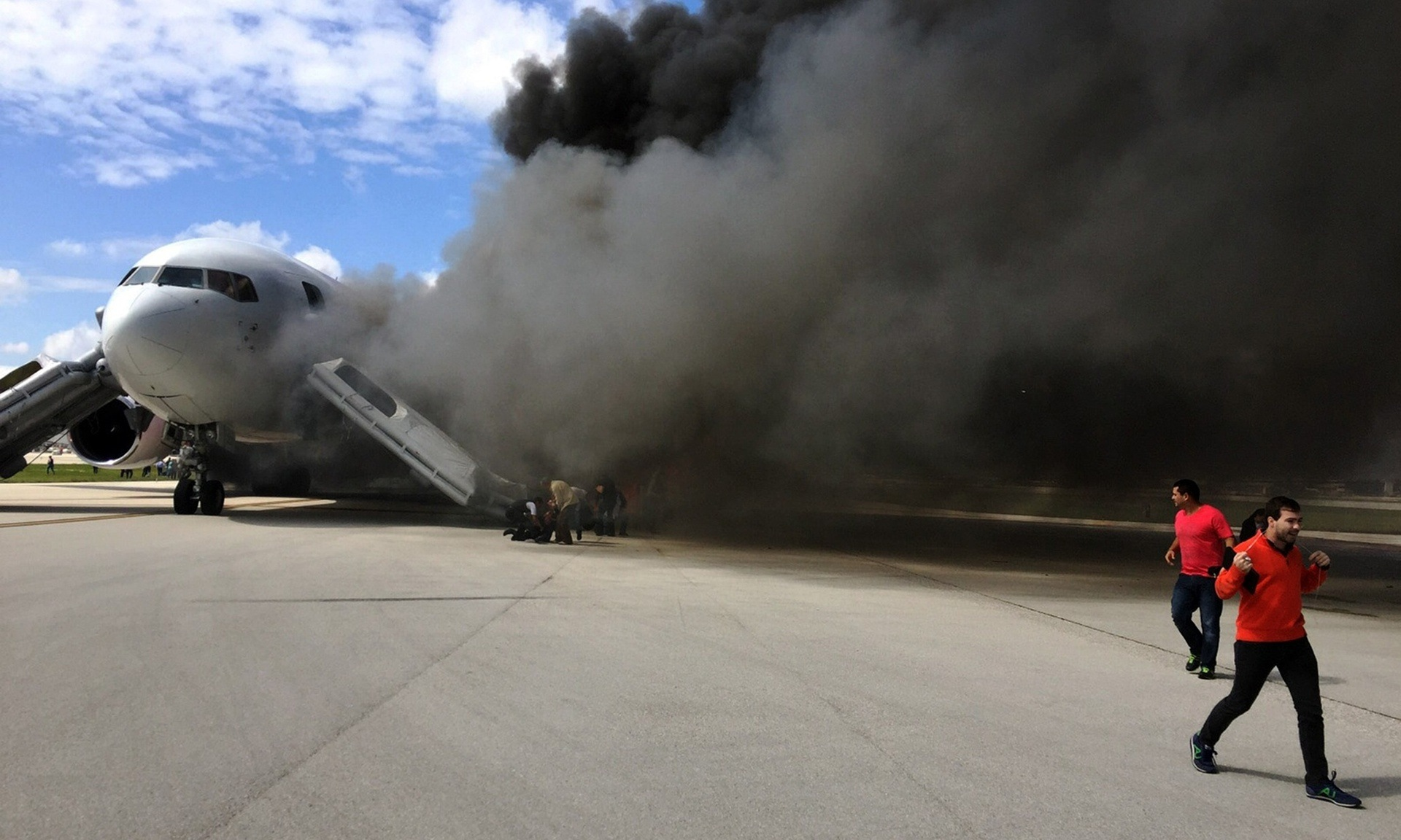 Jet catches fire at Fort Lauderdale airport, Florida