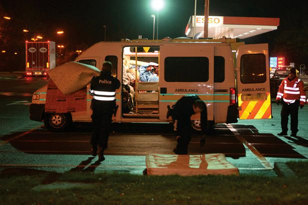 Ambulances-stopped-with-British-suspects-outside-Brussels