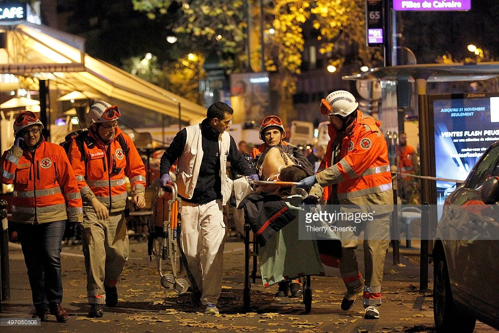 medics-evacuate-an-injured-person-on-boulevard-des-filles-du-calvaire-picture-id497050508