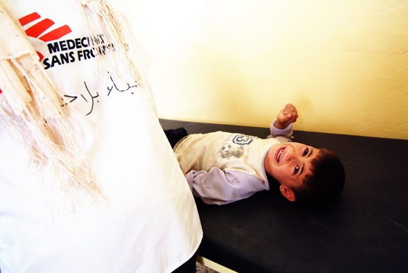 Boy crying in the Primary Health Clinic in Sadr City, North Baghdad.
