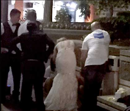 New bride in wedding dress gives CPR to woman on street