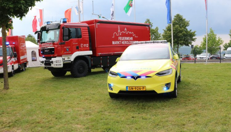 A MAN Feuerwehr truck and a TESLA Model S
