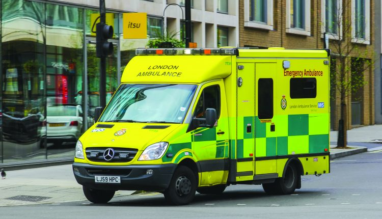 LONDON UK – 5TH APRIL 2014 A London Emergency Ambulance on a road during the day